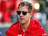Vettel punished for unsafe track return