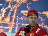 F1 champion Vettel in talks with Ferrari about taking a pay cut
