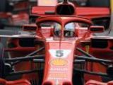 Vettel beats Hamilton to pole
