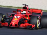 Vettel smashes lap record as Ferrari hints at true pace