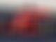 Vettel smashes lap record as Ferrari hints at true pace
