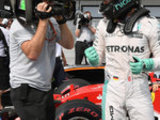 Rosberg wins on day of drama