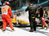 Rosberg leads first practice as Magnussen escapes fire