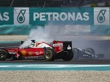 Ferrari F1 driver Vettel defends first-corner Malaysian GP move