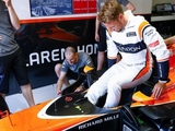 In photos: Button's return to the paddock