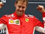 Vettel powers up title charge