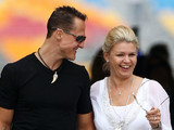 Schumacher 'is here, but different' says wife Corinna