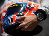 Jenson Button switches back to old helmet colours
