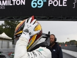 Hamilton elated by record-breaking pole
