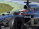 Magnussen takes over at the top