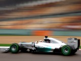 Hamilton masters the wet for pole