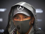 Hamilton reacts to team member testing positive