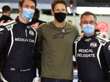 Grosjean back in F1 paddock, reunited with rescuers