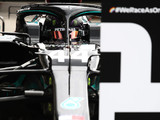 Hamilton eases to eighth Hungarian win, chaos behind