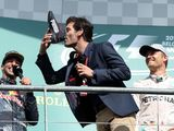Former Aussie F1 driver Mark Webber takes part in podium shoey