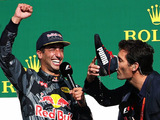Ricciardo's on the podium, and the smile's back on his face
