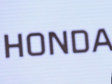 Red Bull 'working hard with Honda'