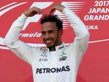 Japanese Grand Prix: Lewis Hamilton wins as Sebastian Vettel retires