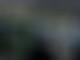 Hamilton takes sensational pole at soggy Sepang
