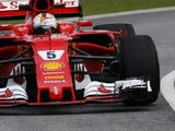 Malaysian GP: Vettel fastest, drain cover crash halts practice