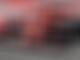 Grosjean leads rain-interrupted morning as Schumacher debuts