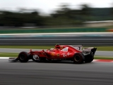 Raikkonen quickest, Vettel slows late on