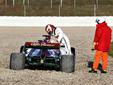 Raikkonen beaches newly-launched Alfa Romeo