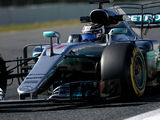 Bottas breaks track record, leads morning session at Barcelona