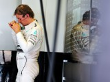 Rosberg to test despite neck pain