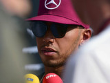 Truculent Hamilton dismisses title talk as silly