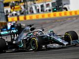 Lewis Hamilton takes victory after controversial penalty for Sebastian Vettel