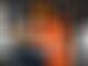Norris helps McLaren mechanics dismantle his car after Hungarian GP