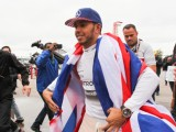 Hamilton overwhelmed by third world title