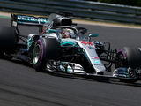 Hamilton masters rain to take Hungarian pole