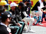 Some F1 drivers take a knee, while others stand