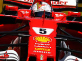 Vettel sets FP2 pace as Grosjean crashes