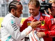 Vettel beats Hamilton for superb pole